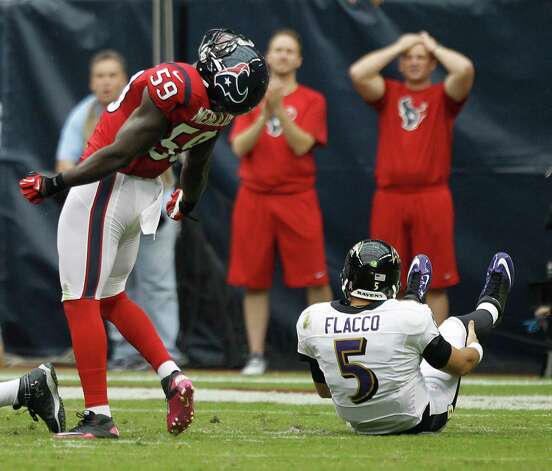 Houston Texans linebacker Whitney Mercilus (59) reacts after stripping the ball from Baltimore Ravens quarterback Joe Flacco (5) during the first quarter at Reliant Stadium on Sunday, Oct. 21, 2012, in Houston. Photo: Brett Coomer, Houston Chronicle / © 2012  Houston Chronicle