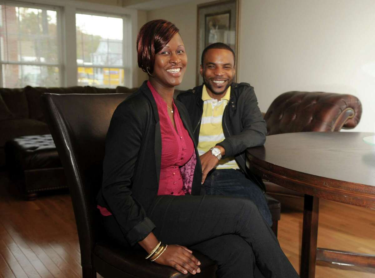 Crystal Blair and her husband, Richard Thompson, sit in their townhouse in Marshall Commons, an affordable housing complex by New Neighborhoods, Inc., in Stamford on Tuesday, October 23, 2012.