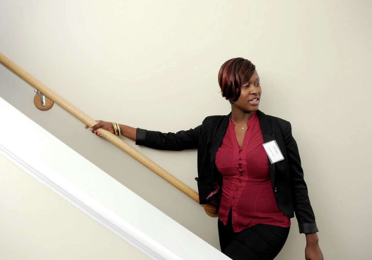 Crystal Blair gives a tour of her townhouse at Marshall Commons, an affordable housing complex by New Neighborhoods, Inc., in Stamford on Tuesday, October 23, 2012.
