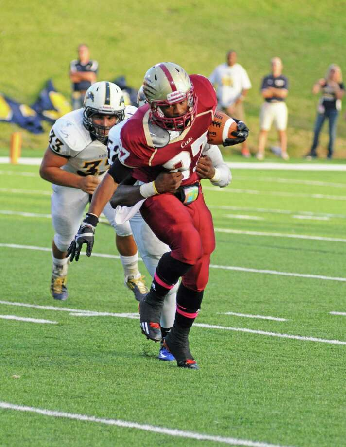 Cy Woods senior running back Trent Holmes (27) fights for extra yards during a 40-37 overtime win against Cy Ranch on 10-20-12 at Pridgeon Stadium. Photo: L. Scott Hainline