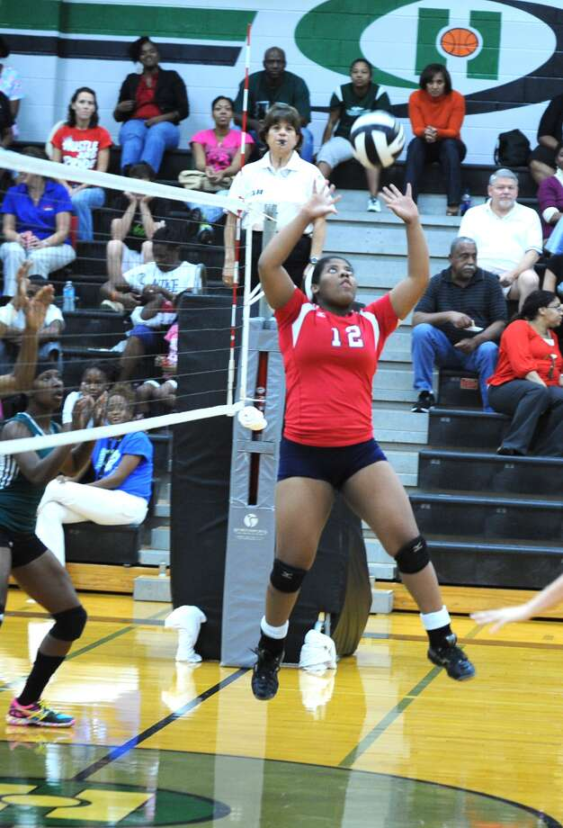Dulles setter Krissy Mouton sets the ball for a teammate in a 3-0 win over Hightower. Photo: Eddy Matchette / Freelance