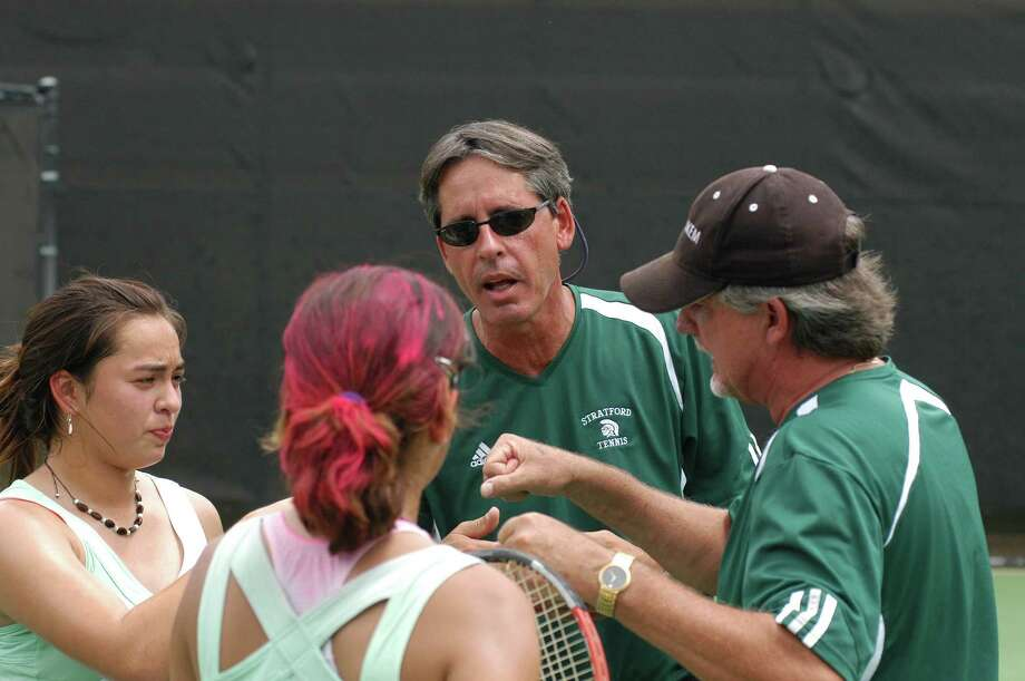 Stratford tennis head coach Rory Frazee (in sunglasses facing camera) talks with his girls doubles team of Carlene Leyden (far left) and Lucy Herrera (red in hair with back to camera) at the UIL State Tournament in Austin on May 7, 2007. Also pictured is Stratford assistant coach Tom Courson (far right in hat). The Stratford girls fell to Corpus Christi Carroll's Jacquelyn Garza and Megan Garcia 6-4, 6-2 in the Class 5A state quarterfinals at the University of Texas Penick-Allison Courts. Photo: L. Scott Hainline / freelance