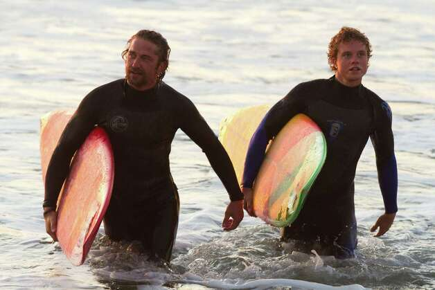 Veteran surfer Frosty (Gerard Butler, left,) trains Jay Moriarity (Jonny Weston) in an extended surfing lesson for the audience. 20th Century Fox Photo: John P. Johnson, Associated Press / Twentieth Century Fox