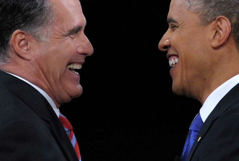 Republican presidential candidate Mitt Romney (left) greets President Barack Obama following the third and final presidential debate at Lynn University in Boca Raton, Fla. Photo: Saul Loeb, AFP/Getty Images / AFP