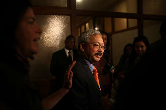 Mayor Ed Lee (center) answers questions from the media at City Hall as Christine Falvey (left), Mayor Lee's spokeswoman, prepares Mayor Lee to leave for his next appointment on Tuesday, October 23, 2012 in San Francisco, Calif.