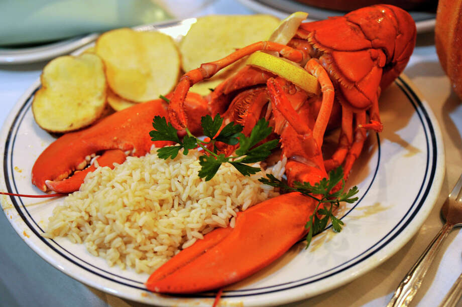 Seafood and meat served Portuguese style with rice and potatoes. 176 Osborne St, DanburyGermany vs. Portugal: June 16 Photo: Jason Rearick / The News-Times