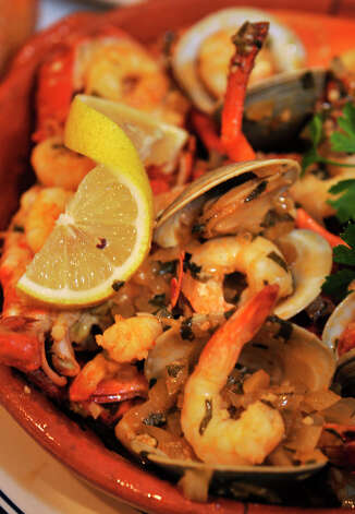 Mariscada - steamed lobster, clams, shrimp and scallops in a wine and butter sauce - is a featured item on The Atlantic Restaurant's menu. Photographed at the restaurant in Danbury on Tuesday, Oct. 16, 2012. Photo: Jason Rearick / The News-Times