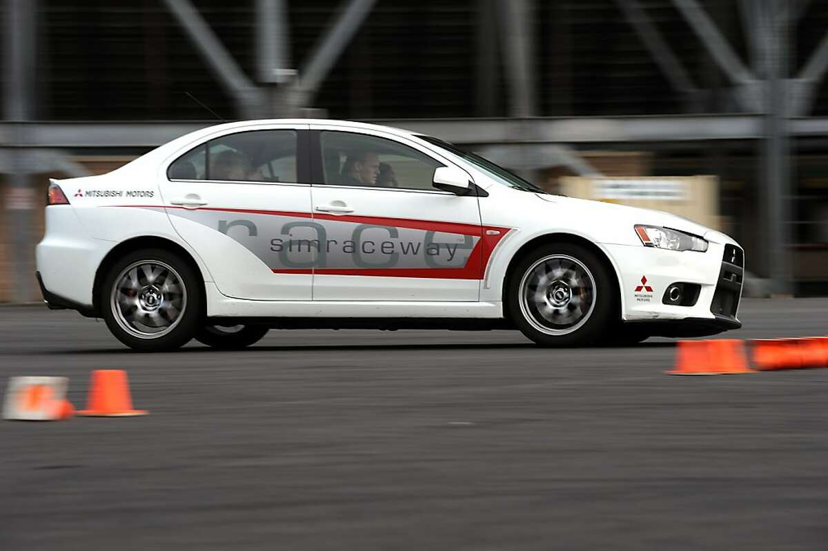 A student driver and instructor race through the course during the