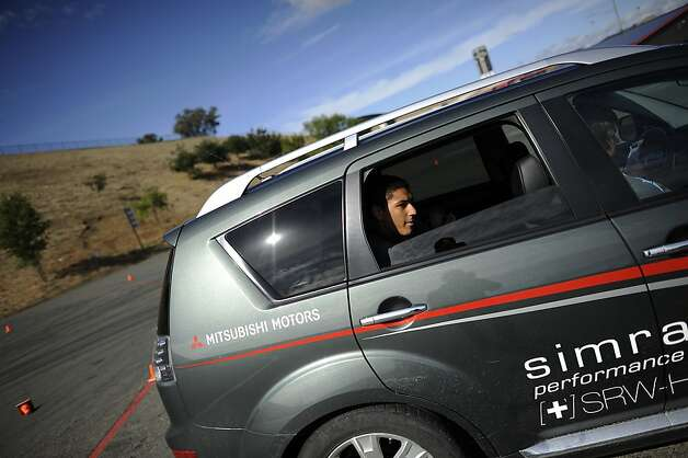 CJ Lyons of Marin Catholic High School sits in the back of a Simraceway Performance Driving Center car before taking one of the 2 driving tests offered.  Sonoma Raceway hosted an event in which teenage drivers are run through various distractions like texting, opening a bottle of water, changing the radio station, etc., so they can see how it can effect their driving.  Sonoma, CA, Tuesday October 23rd, 2012 Photo: Michael Short, Special To The Chronicle
