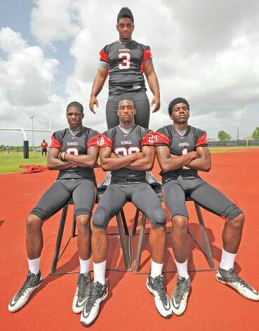 Port Arthur Memorial High School football players Matthew Romar is in back standing.  Front row, left to right is John Leday, Darius Lemora, and Jalen Barnes.  Dave Ryan/The Enterprise Photo: Dave Ryan
