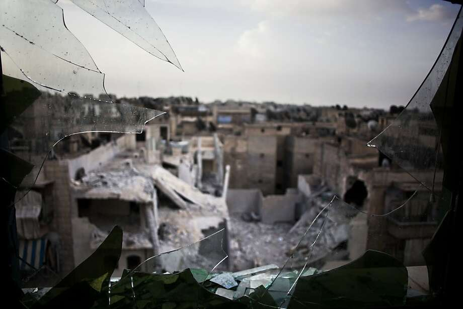 A photograph from Sunday shows damaged buildings from shelling by government forces in Aleppo, Syria. Photo: Manu Brabo, Associated Press