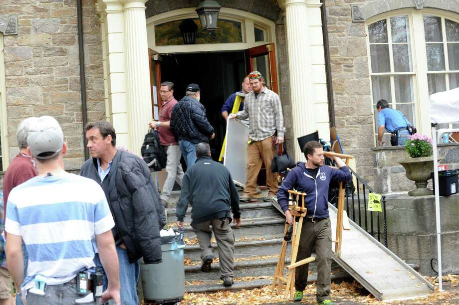 "The crew of the Showtime television series ""The Big C"" pack up their equipment after shooting scenes at the Act II thrift shop of the Second Congregational Church, one of the two locations where shooting was done Tuesday, Oct. 23, 2012. Photo: Helen Neafsey / Greenwich Time"