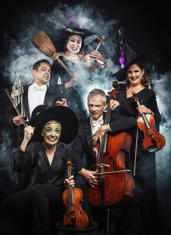 "Houston Symphony Musicians, Tony Prisk (trumpet), left to right, Jennifer Owen (violin), Kiju Joh (violin), Christopher French (Cello), and Sophia Silivos (violin) pose for a portrait in the Houston Chronicle Photo Studio, Monday, Oct. 22, 2012, in Houston.  The Houston Symphony will be presenting ""Haunted Halloween at the Houston Symphony with Berlioz' Symphonie Fantastique."" The finale has a Halloween-related theme: a sinister witches' sabbath.  ( Michael Paulsen / Houston Chronicle ) Photo: Michael Paulsen / © 2012 Houston Chronicle"