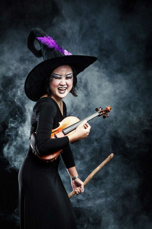 "Houston Symphony Musician Kiju Joh (violin), poses for a portrait in the Houston Chronicle Photo Studio, Monday, Oct. 22, 2012, in Houston.  The Houston Symphony will be presenting ""Haunted Halloween at the Houston Symphony with Berlioz' Symphonie Fantastique."" The finale has a Halloween-related theme: a sinister witches' sabbath.  ( Michael Paulsen / Houston Chronicle ) Photo: Michael Paulsen, Staff / © 2012 Houston Chronicle"