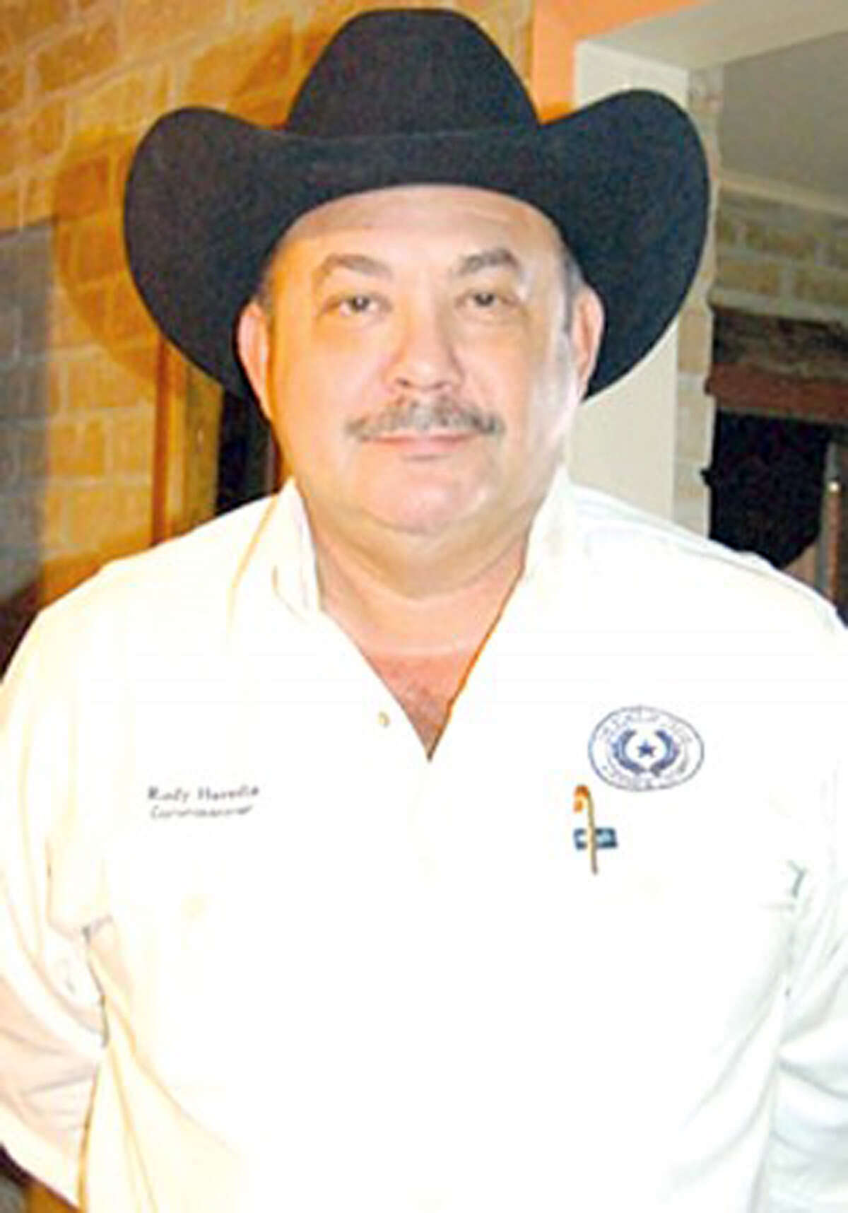 Maverick County Commissioner Rodolfo Heredia is accussed of smuggling money into the United States from Mexico after selling his truck to a Zetas associate.