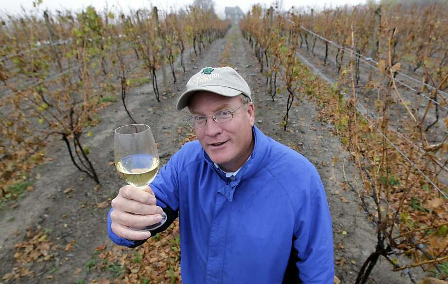 Fred Frank poses for a photo in his vineyard at Dr. Konstantin Frank Vinifera Wine Cellars in Hammondsport, N.Y., Tuesday, Oct. 23, 2012. Frank, grandson of Dr. Konstantin Frank, worries the region's carefully tended reputation is in danger if tourists who make the long trip up from the New York City area and elsewhere have to deal with traffic created by gas drilling. (AP Photo/David Duprey) Photo: David Duprey, Associated Press