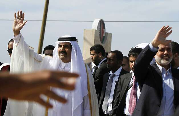 GAZA CITY, GAZA - OCTOBER 23:  The Emir of Qatar Sheikh Hamad bin Khalifa al-Thani (L) and Hamas Prime Minister Ismail Haniyeh of the Palestinian National Authority wave to the crowd as they arrive to a cornerstone-laying ceremony of a Qatari funded rehabilitation center October 23, 2012 in Gaza City, Gaza. The Emir of Qatar received a hero's welcome in Gaza, becoming the first head of state to visit the Palestinian territory since the Islamist militant Hamas seized control there in 2007.  (Photo by Hatem Moussa-Pool/Getty Images) Photo: Pool, Getty Images