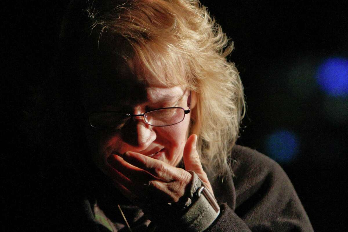 Vicky Armstrong cries as she watches police investigate the crime scene on Clayton Avenue in Clayton NJ on Tuesday Oct. 23, 2012, after the discovery of a girl's body in a home's recycling bin. Gloucester County prosecutors say a body believed to be that of Autumn Pasquale was found around 10 p.m. Monday in the bin just blocks from her house and from Borough Hall, where thousands of people gathered earlier in the evening for a tearful candlelight vigil to pray for her safe return. (AP Photo/ Joseph Kaczmarek)