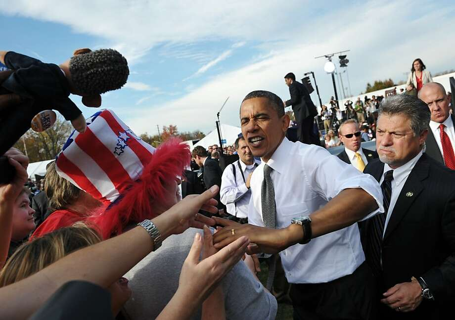 US President Barack Obama greets supporters during a campaign rally October 23, 2012 at Triangle Park in Dayton, Ohio. AFP PHOTO/Mandel NGANMANDEL NGAN/AFP/Getty Images Photo: Mandel Ngan, AFP/Getty Images
