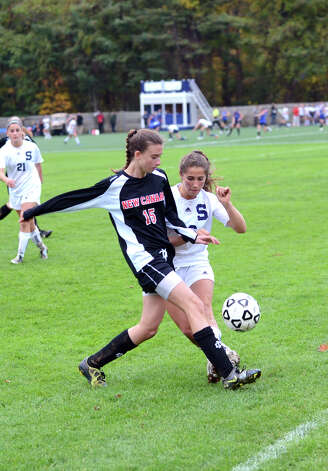 New Canaan's Gabriella Borea (15) controls the ball as Staples' Rebecca Bregman (16) defends during the girls soccer game at Loeffler Field at Staples High School in Westport on Tuesday, Oct. 23, 2012. Photo: Amy Mortensen / Connecticut Post Freelance