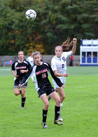 New Canaan's Gabriella Borea (15) and Staples' Olivia Gerrard (2) try to win the ball during the girls soccer game at Loeffler Field at Staples High School in Westport on Tuesday, Oct. 23, 2012. Photo: Amy Mortensen / Connecticut Post Freelance