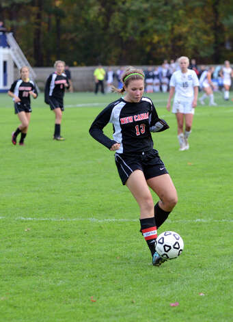 New Canaan's Abigail Sawabini (13) controls the ball during the girls soccer game against Staples at Loeffler Field at Staples High School in Westport on Tuesday, Oct. 23, 2012. Photo: Amy Mortensen / Connecticut Post Freelance