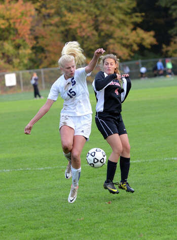 Staples' Ryan Kirshner (15) and New Canaan's Marina Braccio (4) during the girls soccer game at Loeffler Field at Staples High School in Westport on Tuesday, Oct. 23, 2012. Photo: Amy Mortensen / Connecticut Post Freelance