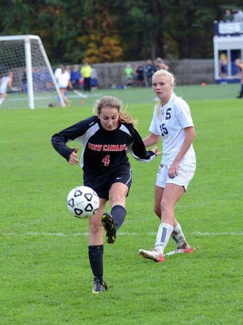 New Canaan's Marina Braccio (4) controls the ball during the girls soccer game against Staples at Loeffler Field at Staples High School in Westport on Tuesday, Oct. 23, 2012. Photo: Amy Mortensen / Connecticut Post Freelance