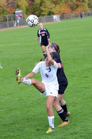 Staples' Lauren Garcia (8) passes the ball over her head during the girls soccer game against New Canaan at Loeffler Field at Staples High School in Westport on Tuesday, Oct. 23, 2012. Photo: Amy Mortensen / Connecticut Post Freelance