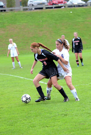 New Canaan's Kyla Persky (18) controls the ball as Staples' Gea Mitas (21) defends during the girls soccer game at Loeffler Field at Staples High School in Westport on Tuesday, Oct. 23, 2012. Photo: Amy Mortensen / Connecticut Post Freelance
