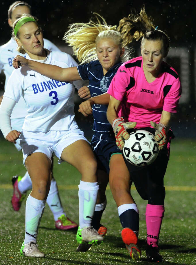Bunnell goalie Hannah Caldwell, right, makes a save, during girls soccer action against Immaculate in Stratford, Conn. on Tuesday October 23, 2012. Photo: Christian Abraham / Connecticut Post