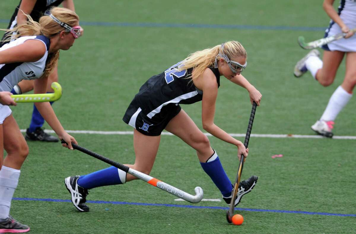 Darien's Claire Culliton controls the ball during their field hockey game against Staples at Staples High School in Westport.