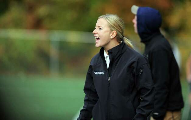 Staples coach Ashley Del Vecchio talks to her team during their field hockey game against Darien at Staples High School in Westport. Photo: Autumn Driscoll / Connecticut Post