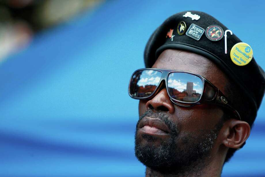 """Ronnie Arnold, 52, who is blind and hearing impaired, listens to the sounds after the """"White Cane Safety Day"""" march upon arriving to City Hall on Tuesday, Oct. 23, 2012, in Houston. Photo: Mayra Beltran, Houston Chronicle / © 2012 Houston Chronicle"""