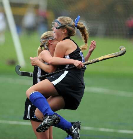 Darien's Sloane Bessey celebrates her goal with a teammate during their field hockey game against Staples at Staples High School in Westport. Photo: Autumn Driscoll / Connecticut Post