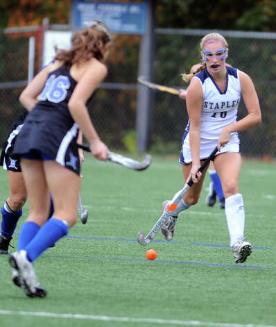 A Staples player controls the ball during their field hockey game against Darien at Staples High School in Westport. Photo: Autumn Driscoll / Connecticut Post