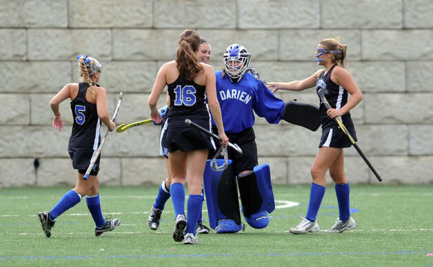 Darien celebrates their win over Staples in their field hockey game at Staples High School in Westport. Photo: Autumn Driscoll / Connecticut Post