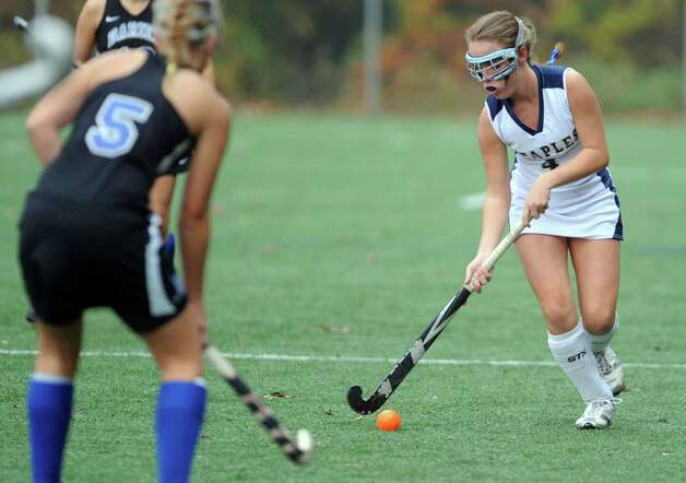 Staples' Josie Fair controls the ball during their field hockey game against Darien at Staples High School in Westport. Photo: Autumn Driscoll / Connecticut Post