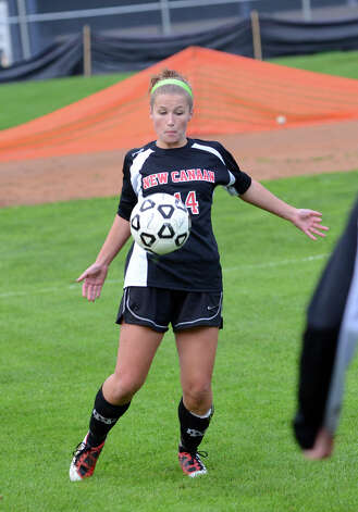 New Canaan's Eileen Dinnie (14) controls the ball during the girls soccer game against Staples at Loeffler Field at Staples High School in Westport on Tuesday, Oct. 23, 2012. Photo: Amy Mortensen / Connecticut Post Freelance