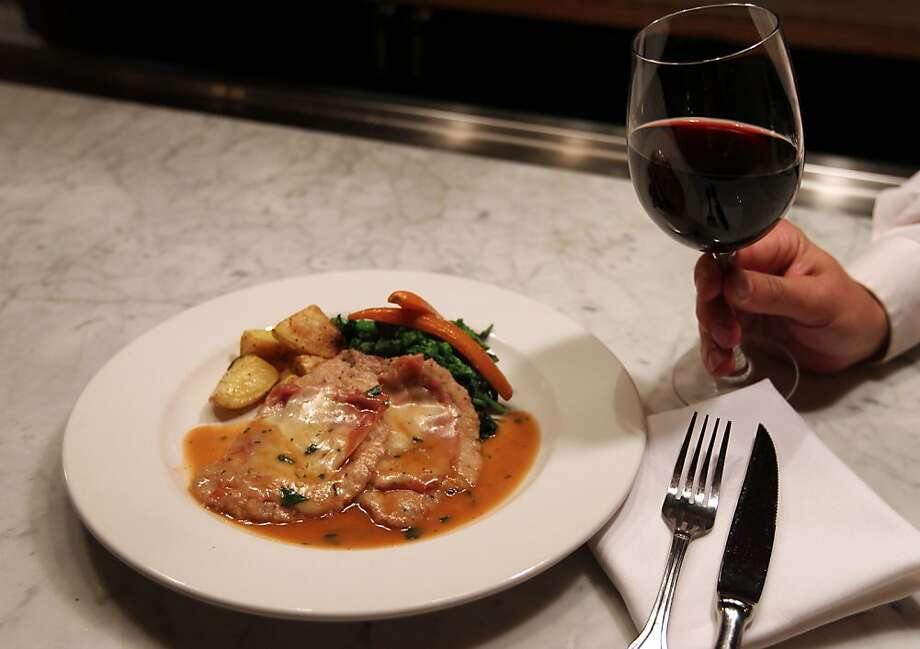 At Manzoni Ristorante Italiano, veal scaloppine with prosciutto and provolone ($24) is a luxurious dish, with a Marsala sauce balancing the rich flavors. Photo: Lance Iversen, The Chronicle