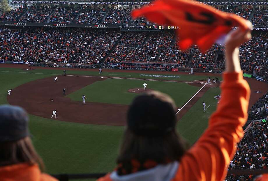 Fans in the view level of AT&T Park cheer as Allen Craig flies out against Matt Cain to end the top of the first inning during Game 7 of the NLCS between the San Francisco Giants and the St. Louis Cardinals at AT&T Park Monday, October 22, 2012 in San Francisco, Calif. Photo: Pete Kiehart, The Chronicle