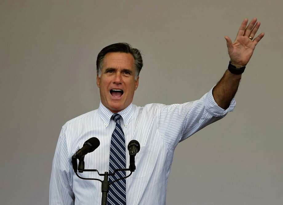 Republican presidential candidate, former Massachusetts Gov. Mitt Romney waves as he speaks to the crowd during a campaign event Tuesday, Oct. 23, 2012, in Henderson, Nev. (AP Photo/David Goldman) Photo: David Goldman / AP