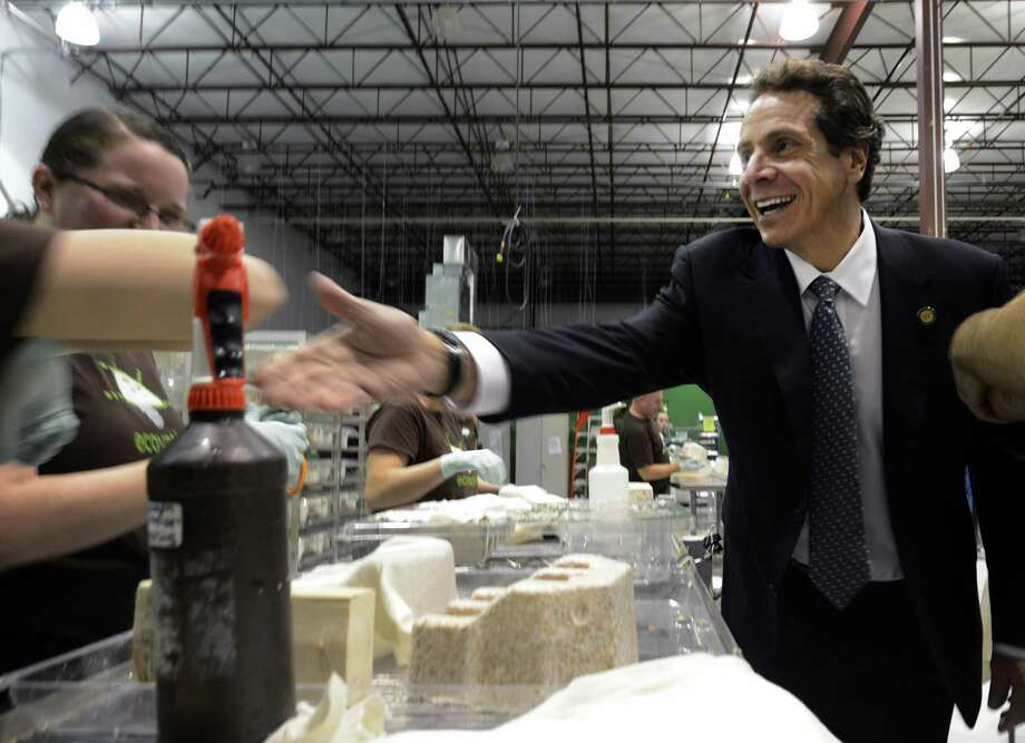 Governor Andrew Cuomo, right meets with workers at Ecovative Company in Green Island, N.Y. Oct 23, 2012 during a tour of local businesses as part of a Economic Development Council program.   (Skip Dickstein/Times Union) Photo: SKIP DICKSTEIN / 10019787A