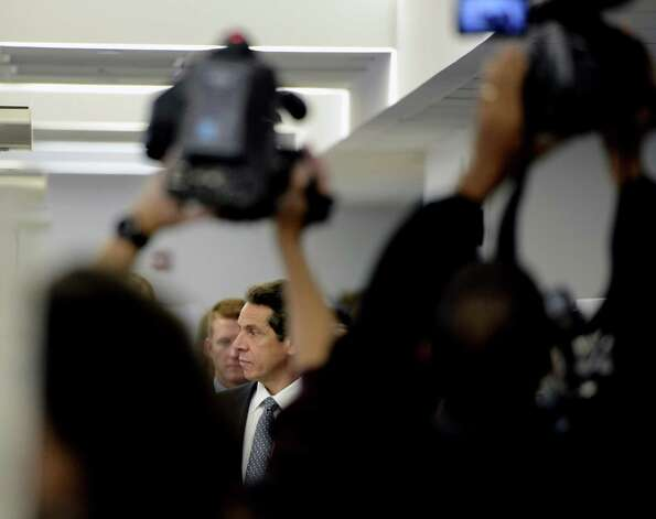 Governor Andrew Cuomo framed by cameramen tours the biology research lab on the RPI campus in Troy, N.Y. Oct 23, 2012.   (Skip Dickstein/Times Union) Photo: SKIP DICKSTEIN / 10019787A