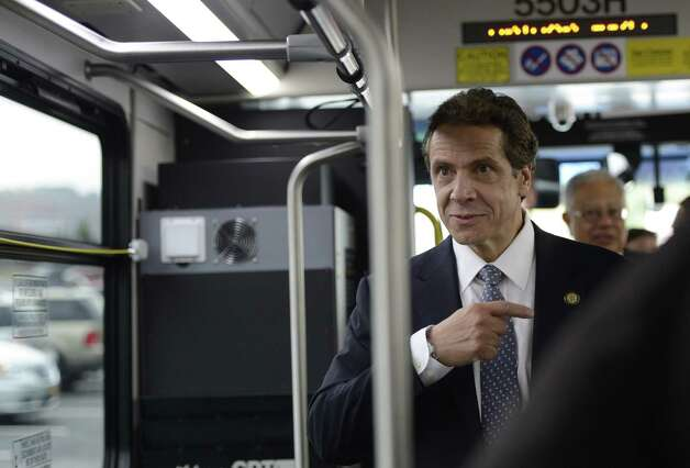 Governor Andrew Cuomo boards a bus in Troy, N.Y. Oct 23, 2012 for a tour of local businesses as part of a Economic Development Council program.   (Skip Dickstein/Times Union) Photo: SKIP DICKSTEIN / 10019787A