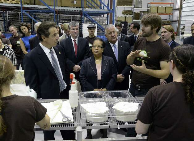 Governor Andrew Cuomo, left meets with the Eben Bayer, president , right at Ecovative Company in Green Island, N.Y. Oct 23, 2012 during a tour of local businesses as part of a Economic Development Council program.   (Skip Dickstein/Times Union) Photo: SKIP DICKSTEIN / 10019787A