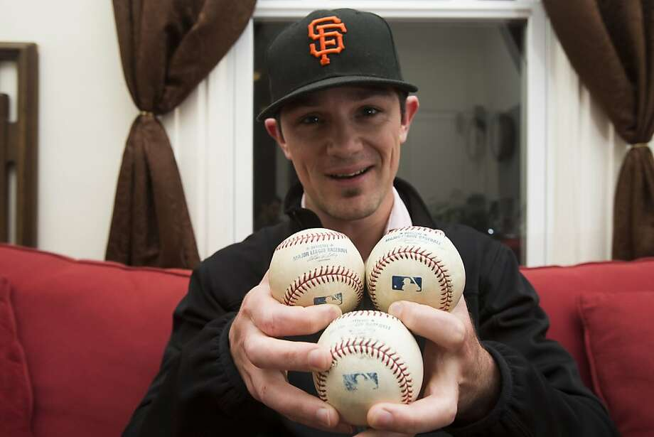 "Tyler Herb of S.F. displays the three special foul balls from AT&T Park, which he believes have a special ""mojo."" Photo: Stephen Lam, Special To The Chronicle"