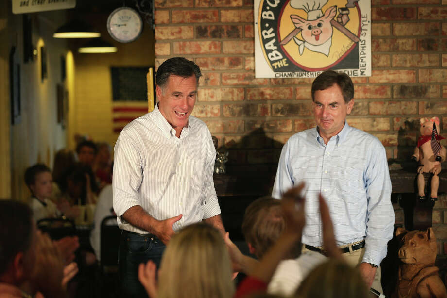 The new order in Washington, D.C.: President-elect Mitt Romney confers on social policy and contraception with Indiana's Sen.-elect Richard Mourdock, one of the Tea Party's big winners in November. Photo: Scott Olson, Getty Images / 2012 Getty Images