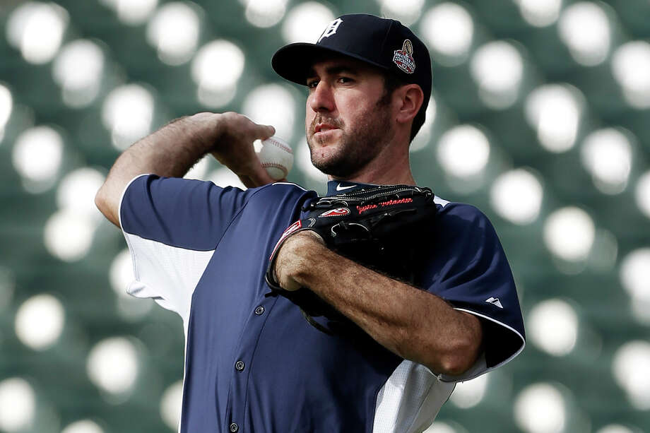 Detroit Tigers pitcher Justin Verlander throws during a workout at Comerica Park in Detroit, Monday, Oct. 22, 2012. When Dave Dombrowski first took over as president of the Detroit Tigers, they lost 225 games his first two seasons. But in 2004, Detroit drafted Justin Verlander, the first step toward building one of baseball's glamour teams in the heart of the Motor City. The Tigers will play the winner of the San Francisco Giants-St. Louis Cardinals National League Championship Series in the World Series. (AP Photo/Paul Sancya) Photo: Paul Sancya / AP
