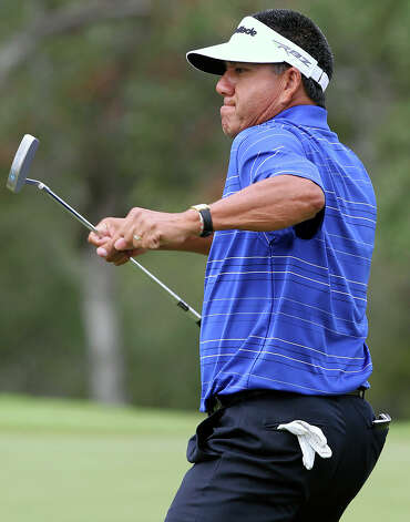 Esteban Toledo pumps a left hook as he sinks a birdie on his first hole as golfers practice for the AT&T Championship  on October 23, 2012. Photo: Tom Reel, San Antonio Express-News / ©2012 San Antono Express-News